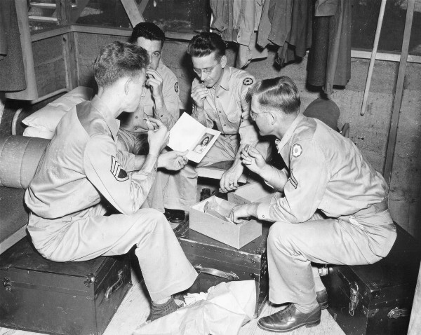 Soldiers enjoy a package of cookies